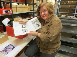 Dr Stafford and the catalogue of Marian Macguire's work showing the Amazons of New Zealand